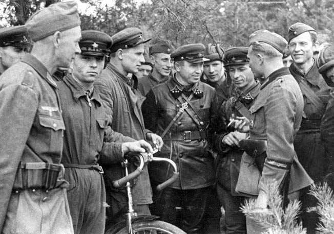 Russian troops from the 29th Tank Brigade meet up with their German counterparts in Dobuchin, Poland (now part of Belarus). Hitler and Soviet leader Josef Stalin had a secret pact to divide up Poland between them after Germany's invasion.