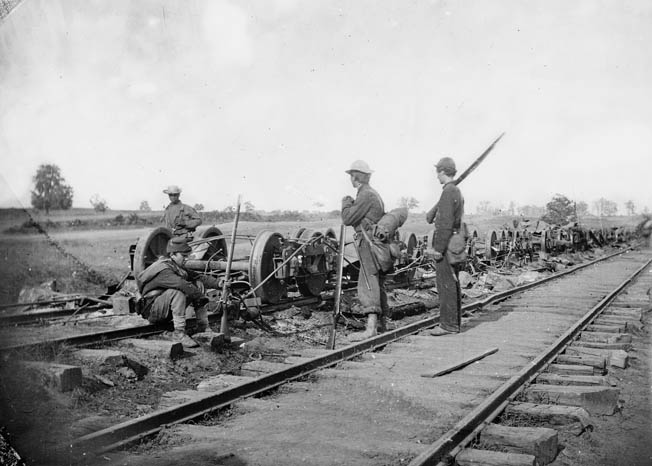 Union soldiers survey the damaged rolling stock of the Orange & Alexandria Railroad at Manassas Junction shortly before the Battle of Brawner's Farm. The junction was fought over frequently during the war.