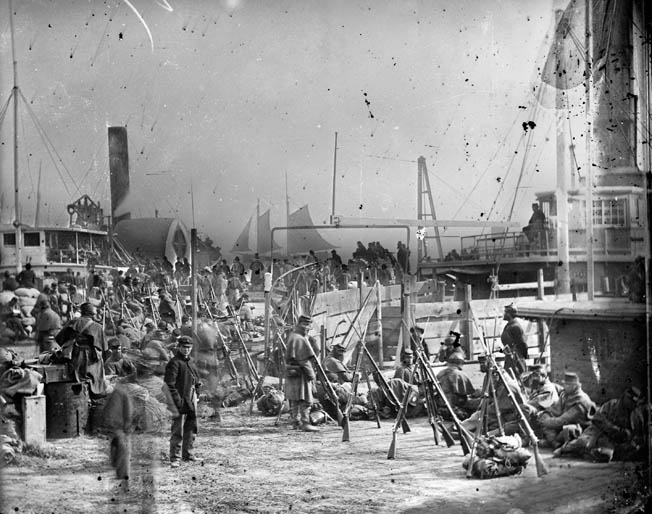 Union soldiers in IX Corps board transports at Aquia Creek Landing, Virginia, en route to join Maj. Gen. Ambrose Burnside's forces in Kentucky. The corps would be diverted to Vicksburg, Mississippi, first.