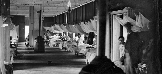 Mosquito netting hangs above patients' beds at Washington's Harewood Hospital in an effort to lessen malaria outbreaks.