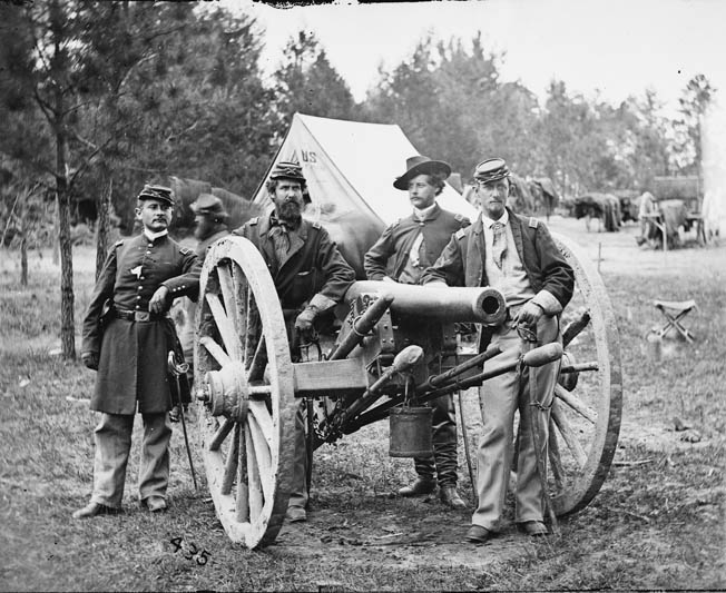 Captain John C. Tidball, second from left, poses with his Battery A, 2nd U.S. Artillery, at Fair Oaks, Virginia. Tidball eventually became a major general.