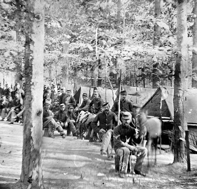 Men of Companies C and D, 1st Massachusetts Cavalry, rest in camp after guarding the Union rear at Catlett's Station.