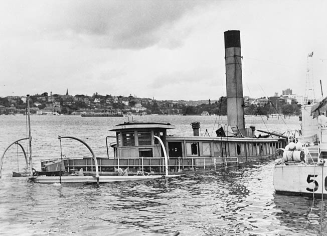 The depot ship HMAS Kuttabul was serving as a floating barracks in Sydney Harbor on the night of the attack by Japanese midget submarines. A torpedo passed beneath the vessel and detonated nearby. Twenty-one men were killed in the explosion.
