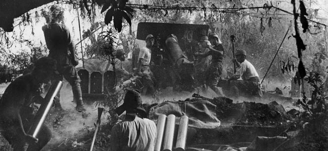 WORLD WAR II: PHILIPPINES. Battle of Bataan Island (Luzon): Japanese artillery position. Photograph, March 1942.