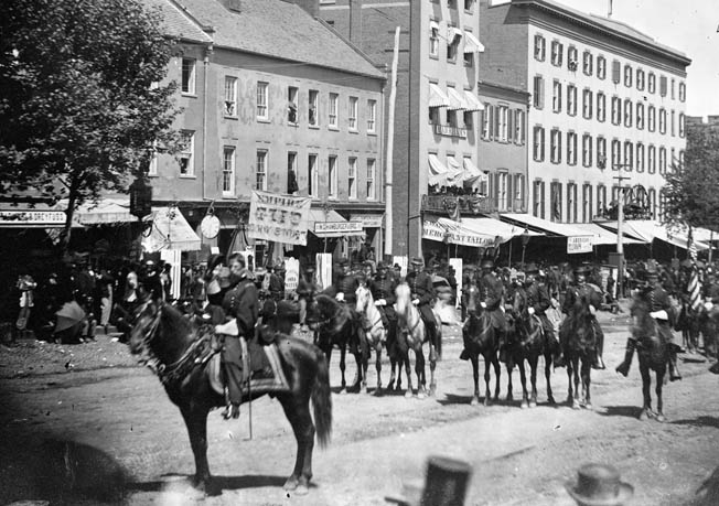 Mounted officers pause on Pennsylvania Avenue during the review. Maj. Gen. George Armstrong Custer, as usual, created a stir when his horse, Don Juan, suspiciously bolted toward the reviewing stand before the general brought it under control.