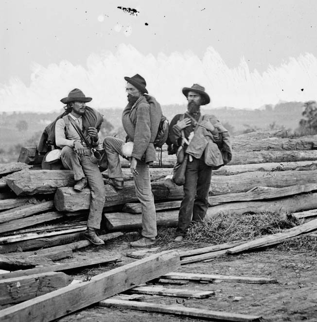 This image of three hard-bitten Confederates, taken prisoner at Seminary Ridge outside Gettysburg, is one of Mathew Brady's most iconic photographs. The town itself is visible in the background at left.