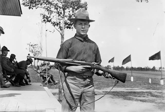 A U.S. soldier poses proudly with his new Springfield in this early, undated photo.