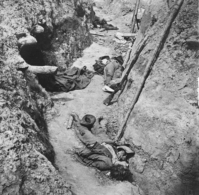 Dead Confederate soldiers lie fallen in the fetid trenches of Fort Mahone, outside Petersburg, Virginia. A former Brady associate, Thomas C. Roche, recorded the macabre image.