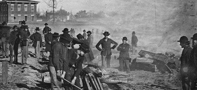 "Maj. Gen. William Tecumseh Sherman's notorious ""bummers"" destroy a section of railroad at Atlanta, Georgia, in the summer of 1864. Photographer George N. Barnard was one of the few to record the Civil War in the Western theater."