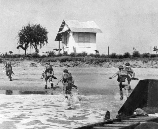 In this photo taken during the progress of the campaign to secure Madagascar from Vichy French forces, British Commonwealth soldiers rush ashore on the large island in the autumn of 1942. The fight for control of Madagascar was sharp and costly as the British sought to secure it from possible Japanese occupation.