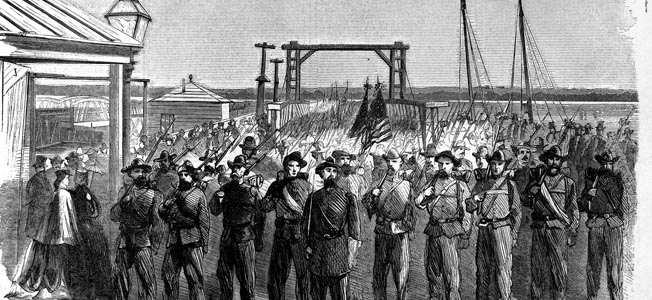Major General William Tecumseh Sherman's western troops cross the Long Bridge from Virginia en route to their second-day appearance in the Grand Review. The men proudly wore their tattered old uniforms, bespeaking their arduous service in the war.