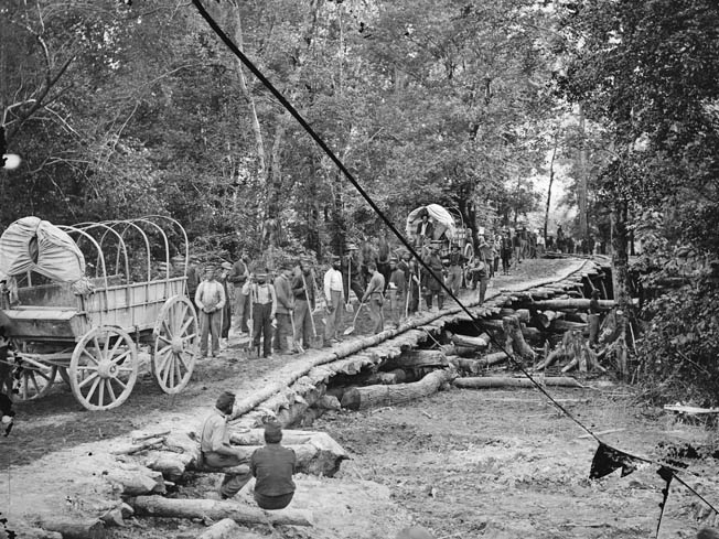 Members of the 5th New Hampshire Infantry admire their work on the hastily constructed Grapevine Bridge across the Chickahominy River at Seven Pines. The rough bridge was crucial to funneling reinforcements to the battlefield.