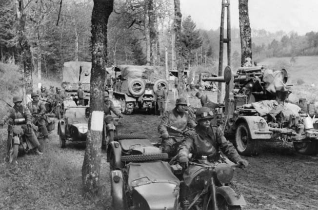 "A German motorized column streams through the ""impenetrable"" Ardennes Forest in the opening days of Hitler's attack in the West, May 1940."