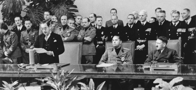 TRIPARTITE PACT, 1940. After signing the Tripartite Pact on September 27, 1940, Japanese Ambassador to Germany Saburo Kurusu addresses a gathering in Berlin. Hitler (right) and Italian Foreign Minister Count Galeazzo Ciano look on.