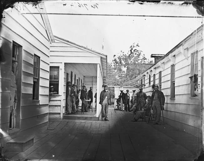 Convalescing soldiers and staff outside a Sanitary Commission lodge, one of 30 such facilities operated by the Commission in Washington during the war. Whitman didn't think much of the Sanitary Commission.