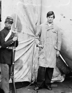 Prisoner Lewis Paine, who attempted to assassinate Secretary of State Henry Seward, is guarded by a Marine at the Washington Navy Yard.