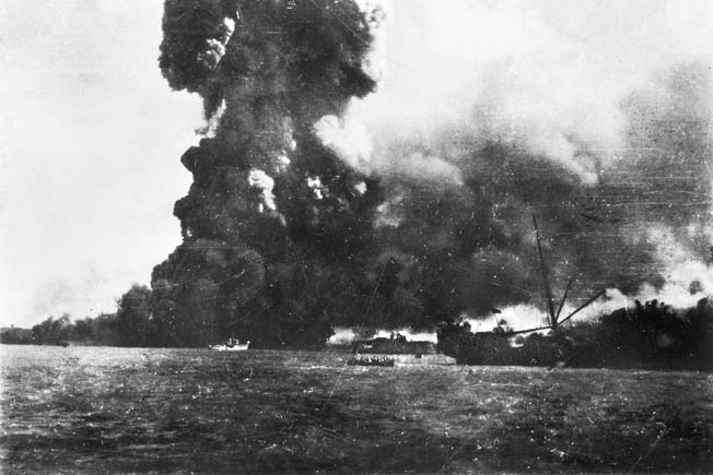 A catastrophic explosion signaled the end of the cargo motor vessel Neptuna, hit by Japanese bombers during the air raid. Neptuna was launched in 1924 and served in the merchant marine fleets of both Germany and Australia.