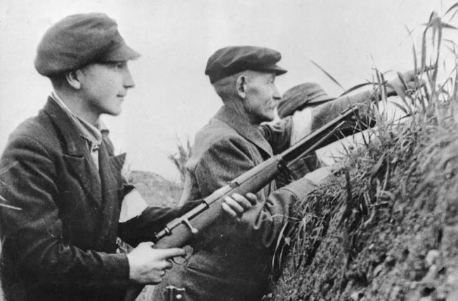 In October 1944, German civilian residents of an East Prussian town are undergoing training for the Volkssturm, units composed of old men and boys who offered a last line of defense against the marauding Red Army. These ill-prepared men are thus far without uniforms and fielding antiquated weapons.