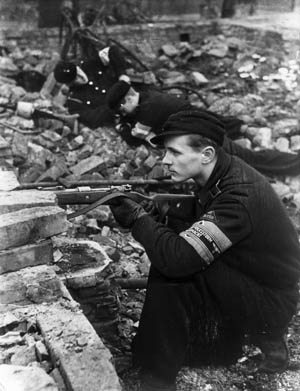 Members of the Hitler Youth take up defensive positions in the rubble of Berlin.
