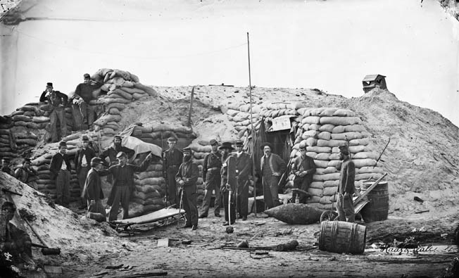 Union troops man the second parallel of trenches on Morris Island following a successful surprise assault on Confederate fortifications in September 1863. Fort Sumter, in Charleston harbor, remained the lone holdout.
