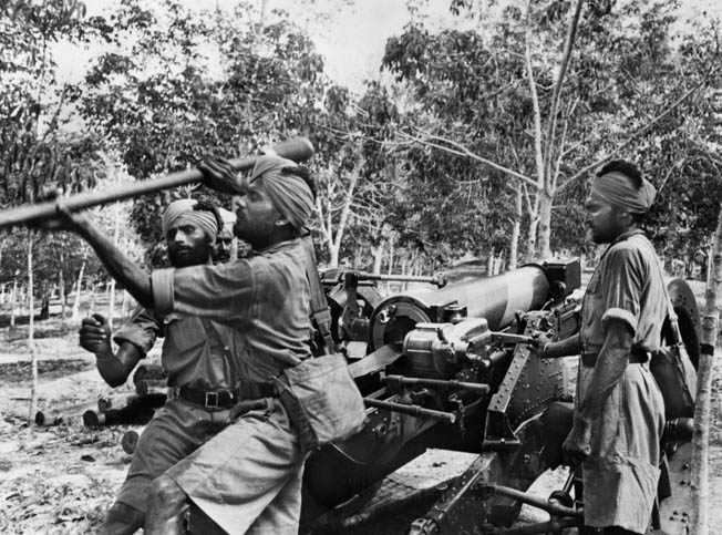 Soldiers from other parts of the British Empire defended Singapore. Here, Sikh soldiers train with an artillery piece in late 1941. They would be overrun by the Japanese.