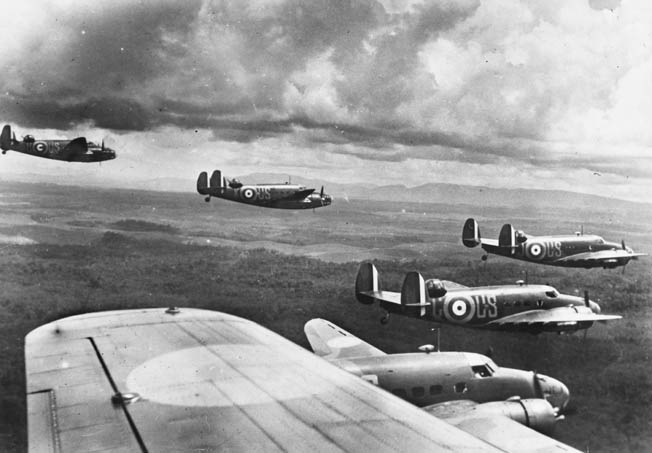 A flight of American-made Royal Australian Air Force Lockheed Hudsons cruises over Malaya shortly before the Japanese invasion.