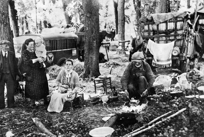 Camping in a forest near Paris, these refugees appear somewhat bewildered by the sudden series of events that has made them homeless. The swiftness of the German advance through France and the Low Countries in the spring of 1940 took the world by surprise and resulted in the mass dislocation of many citizens of France, Belgium, the Netherlands, and Luxembourg.