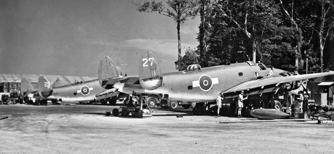 RNZAF ground personnel service Lockheed Ventura PV1 medium bombers on Green Island in the Solomons, December 1944. The versatile PV1 replaced the Lockheed Hudson.