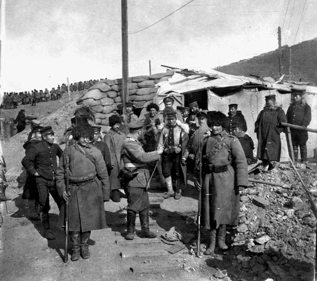 Japanese sentries relieve their Russian counterparts following the formal Russian surrender of Port Arthur on January 1, 1905. The victors sustained at least 60,000 casualties during the brutal five-month siege.