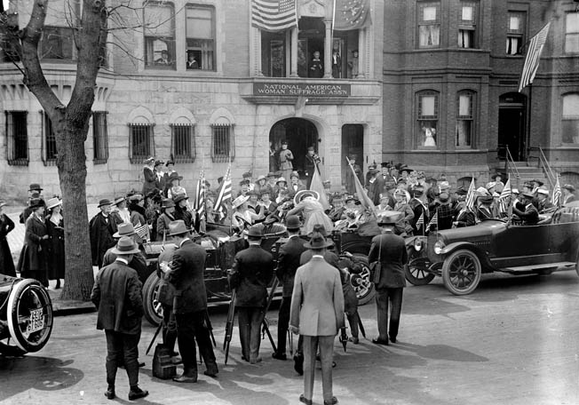 Fellow suffragettes gather around a car carrying Jeanette Rankin, who was already a controversial figure, during a 1917 rally.