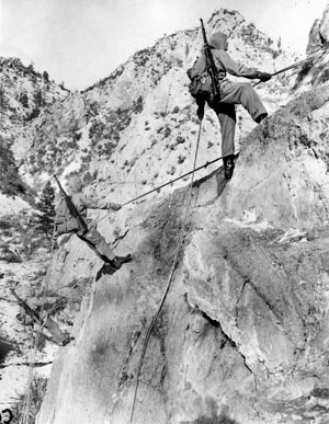 Besides parachute training, the 1st SSF also became proficient at mountain operations. Here Force men climb a Rocky Mountain peak at Fort William Henry Harrison, Montana.