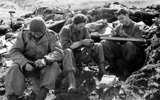 The 1st SSF was part of a 35,000-man combined U.S.-Canadian operation to evict a Japanese force from Kiska Island in the Aleutian chain, but the enemy withdrew just days before Operation Cottage began in August 1943. Here 1st SSF troops service their weapons after a fruitless patrol.
