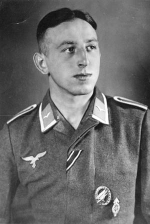 "Luftwaffe paratrooper Richard Statetzny photographed in March 1942 at the infantry training school at Döberitz near Berlin. He is wearing the ""diving eagle"" Fallschirmjäger badge, the Hitler Youth proficiency badge, and the ribbon for the Iron Cross."