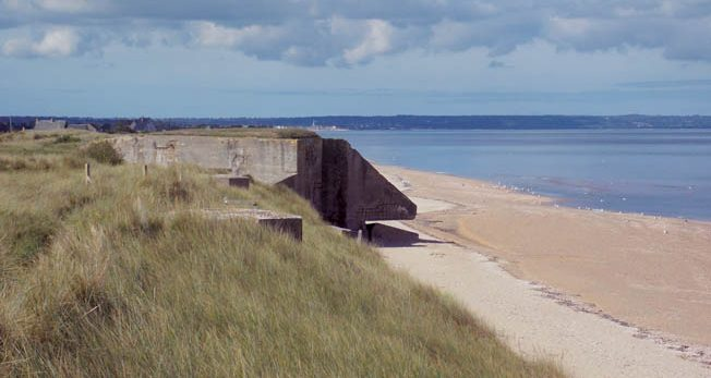 Seventy years after the invasion, this shell-marked bunker at La Madeleine still looms menacingly over the sands of Utah Beach, where the U.S. 4th Infantry Division came ashore on D-Day.
