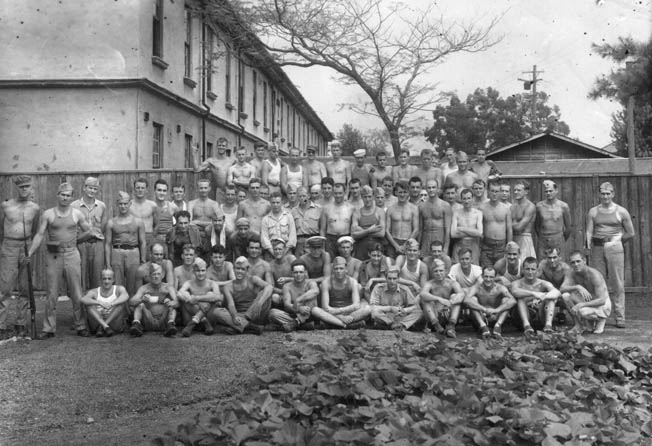 Former coastwatcher John Jones is circled at upper right in this image of a group of Allied prisoners of war at the Zentsuji prison camp in Japan. The photo was taken shortly after the prison was liberated.