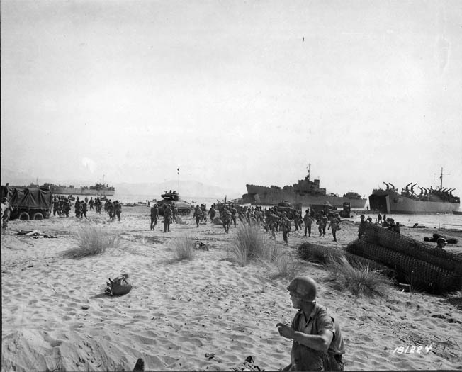 Allied landing ships unload men and tanks on the beach south of Salerno on the first day of the battle. German guns on the mountains 10 miles from the beach pummeled supply and landing transports as they offloaded men and equipment.