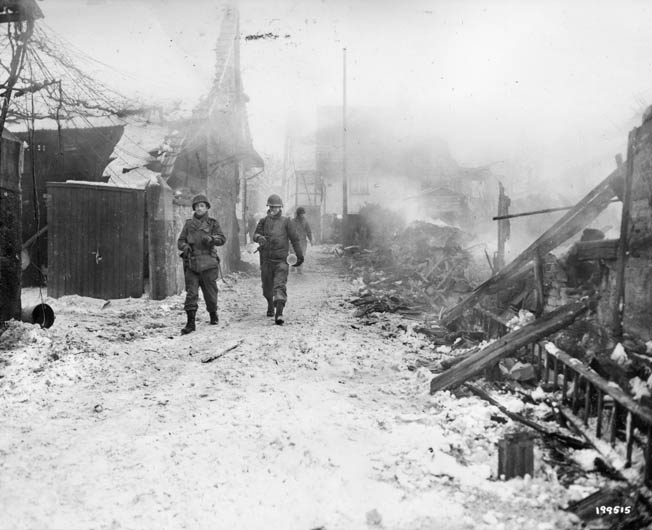 On January 20, 1945, the 103rd Infantry Division pulled back across the Moder River into France. After retaking a French town from SS troops, American soldiers of the 103rd Infantry Division start out on patrol.