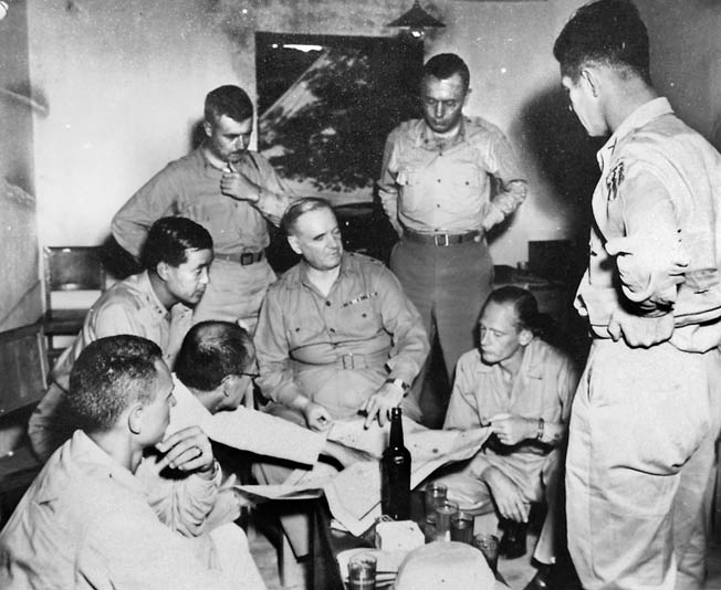"General William ""Wild Bill"" Donovan meets with  his officers in the city of X'ian, China. Donovan  created a separate OSS intelligence collection apparatus in Chinato conduct his own OSS operations."