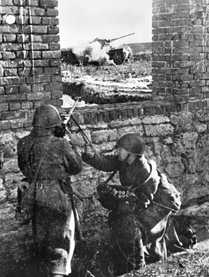 Soviet soldiers fire a  PTRD-41 antitank rifle from a protected position at a German tank on the Eastern Front in 1943. Although not powerful enough to pene- trate the thick frontal armor of German tanks, the rifles were capable of breaking through their thinner side and rear armor.