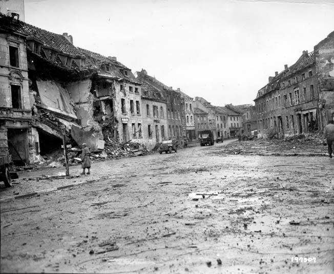 Having occupied the town of Geilenkirchen, American troops move through the ruins and on to their next engagement against the tough German enemy. This image was taken on November 21, 1944, two days before most of the fighting in the area ended.