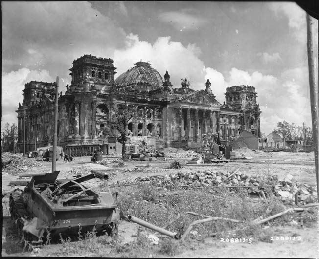The shattered remains of the German Reichstag, where German defenders held out for several days against Soviet assaults. This photo was taken in August 1945. The building was partially renovated in the 1960s but would not be fully restored until 1999.
