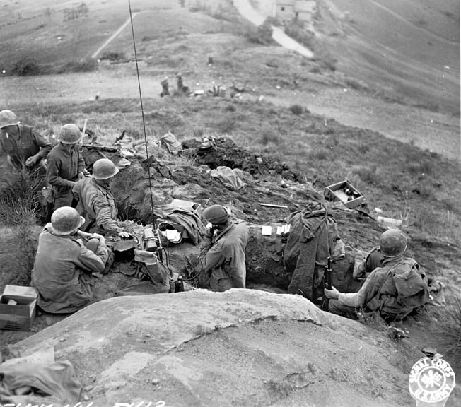 Troops of the 91st Infantry Division man entrenchments near the village of Livergnano along Highway 65. The fighting here lasted October 9-15, 1944.