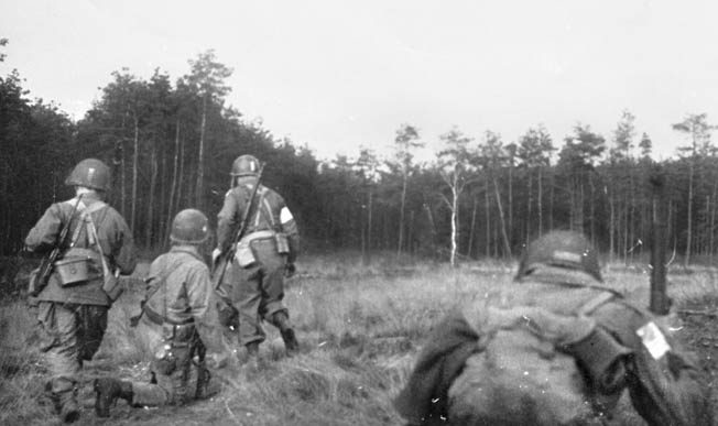 """Immediately after landing, men of the 507th PIR, known as """"Raff's Ruffians,"""" head for their objective, the Diersfordt Castle."""