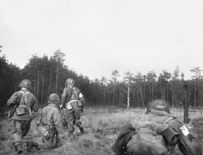 "Immediately after landing, men of the 507th PIR, known as ""Raff's Ruffians,"" head for their objective, the Diersfordt Castle."