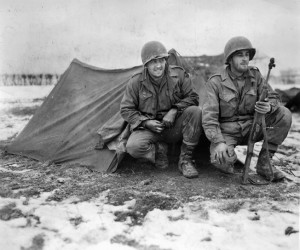 Two men of the 372nd Field Artillery Battalion, 99th Division pose for a photographer on the day before the Germans unleashed their Ardennes Offensive. Sergeant Walter believed the German artillery barrage that preceded the ground offensive was intended to knock out American guns some distance behind the 99th Division's defensive perimeter.