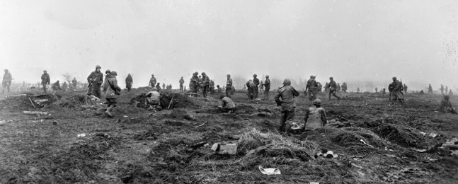 On the morning of December 20, 1944, the day after Walter and his platoon safely arrived inside American lines, soldiers of Companies A, B, C, and D, 393rd Infantry Regiment, 99th Division reposition their foxholes in the vicinity of the town of Elsenborn.