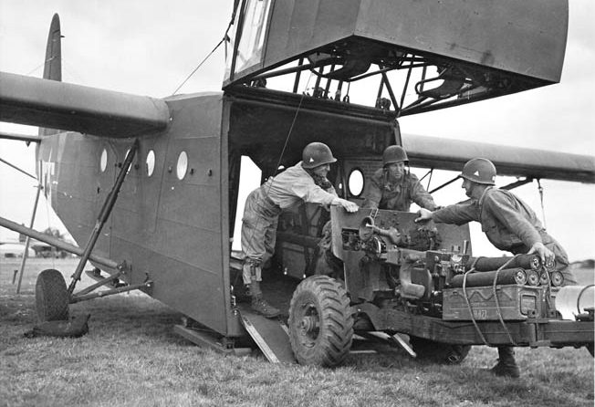 A 57mm antitank gun is loaded into a Waco glider on September 16, 1944, in preparation for the drop into Holland. The nose of the glider was hinged to allow for large pieces of equipment to be loaded and off-loaded.