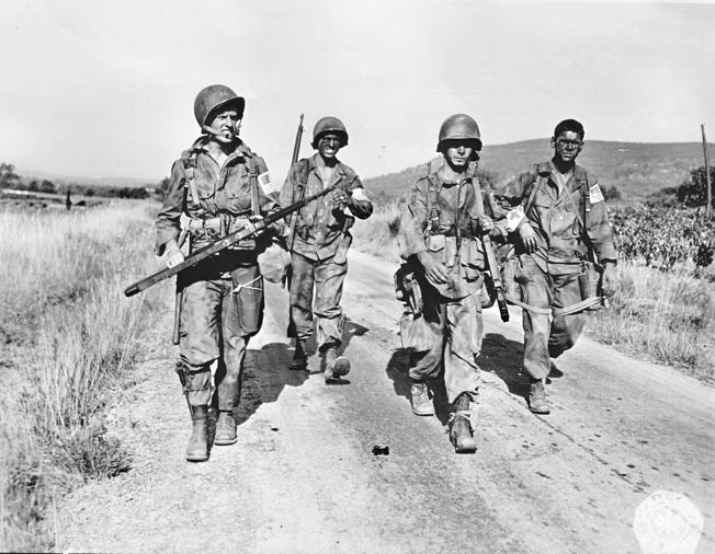 After parachuting into southern France, these First Airborne Task Force troopers head down a road near Le Muy, August 15, 1944.
