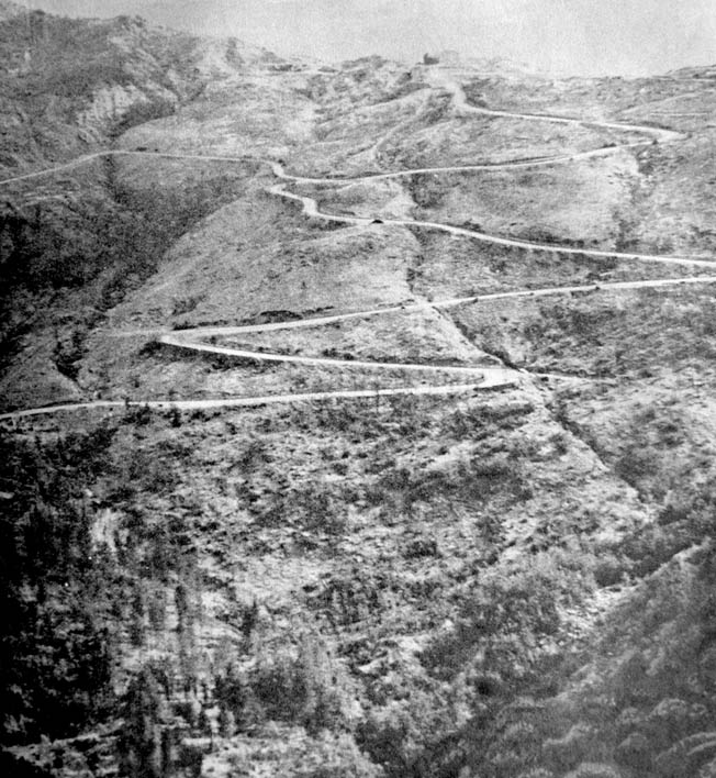 Looking northward at the switchback road (Highway 6524) running up to Il Giogo Pass, September 13, 1944.