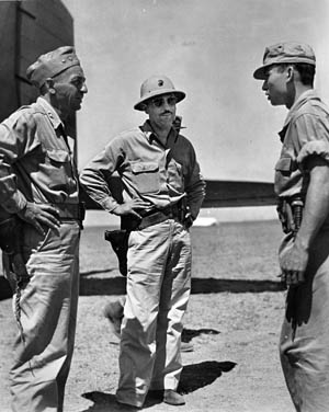 Colonel Lyle Meyer (center), commander of Marine Air Group 24, carried out close-air ground support missions in support of the Army.
